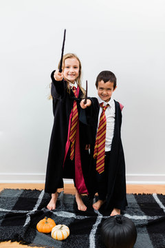 Brother and Sister Dressed up In Harry Potter Costume