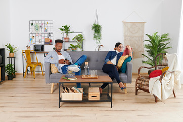 Multiethnic couple spending time together at living room