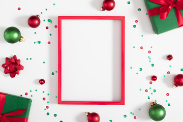 Christmas modern composition. Red photo frame, Xmas decorations on white background. Christmas, New Year, winter concept. Flat lay, top view, copy space