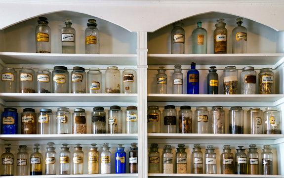 old medicine bottles on shelves