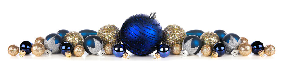 Wall Mural - Christmas border of deep blue and gold ornaments. Side view isolated on a white background.