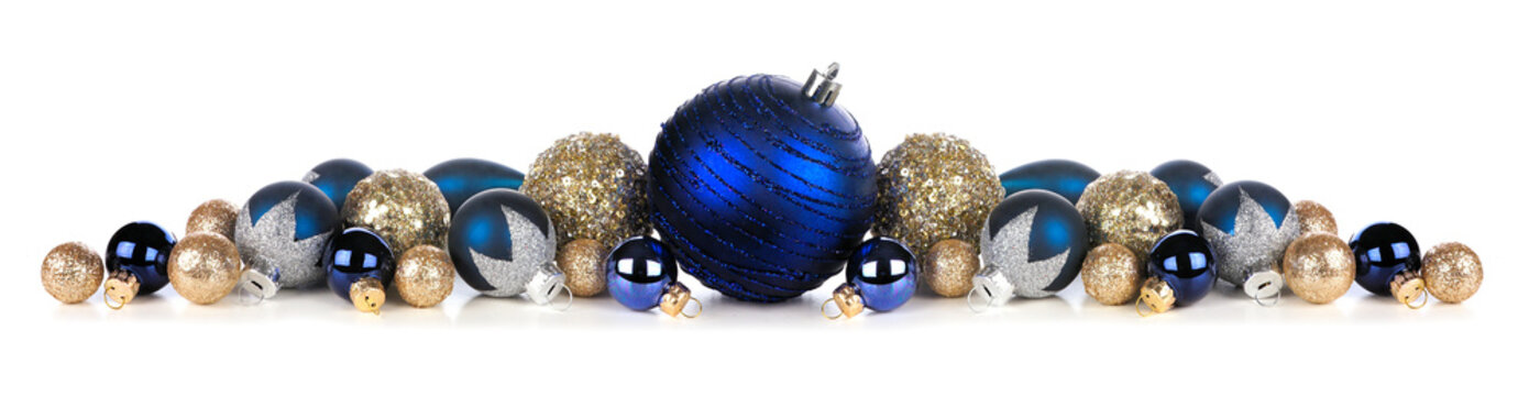 Christmas border of deep blue and gold ornaments. Side view isolated on a white background.