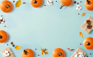 Wall Mural - Autumn theme with orange pumpkins - flat lay