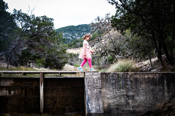 Girl walking in hill country