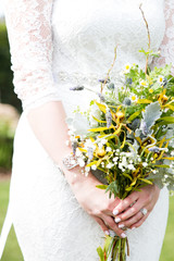 Bride with Yellow White and Green Bouquet