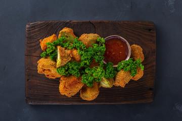Photo sur Aluminium Buffalo Vegan snack Buffalo wings made from roasted broccoli top view. Tasty vegetarian food top view