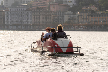 kids and mother on a pedal boat