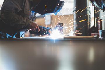 Professional technicians are welding metal materials.