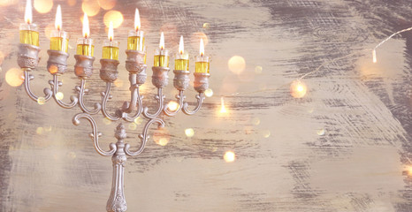 Religion image of jewish holiday Hanukkah background with menorah (traditional candelabra) and oil candles