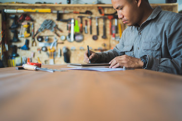 Professional technicians are designing furniture with computers.