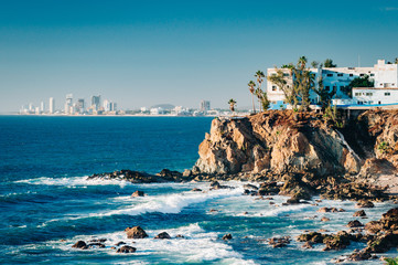 Mazatlan as seen from afar with a spectacular cliff line in the foreground Wall mural