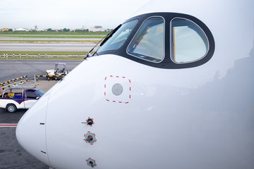 Cockpit view of modern airplane is parking at an airport before pilot and passenger come.