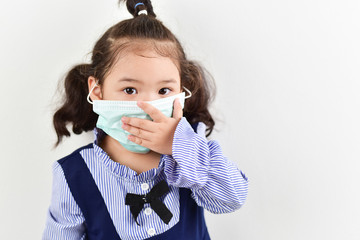 A girl wearing a germ protection mask