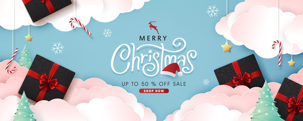 Wall Mural - Christmas composition in paper cut style sale banner background.Merry Christmas text Calligraphic Lettering Vector illustration.