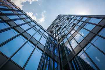 Looking up at modern business buildings in the economic zone