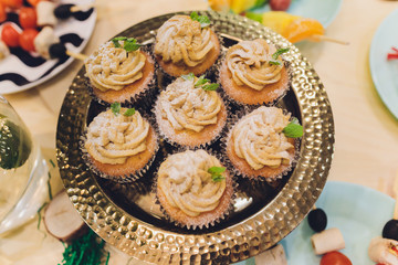 Homemade Carrot Cupcakes with Cream Cheese Frosting for Easter.