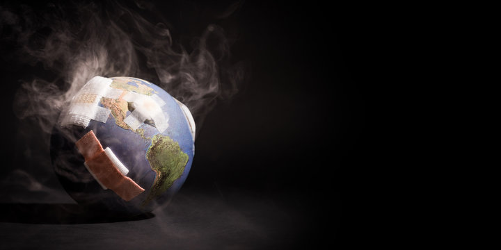 White smoke cover around the globe (World) full of bandages, demonstrating impact of global warming, climate change, pollution from Fossil Fuels Burning, Deforestation, Industrial Revolution.