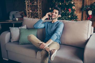 Portrait of joyful positive guy sit comfort couch communicate smartphone congratulate family 2020...