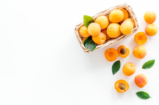 Collect apricots, white background top view copy space, pattern with leaves