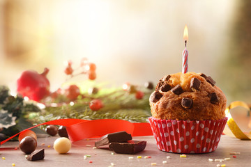 Chocolate muffin with red white polka dot paper and candle