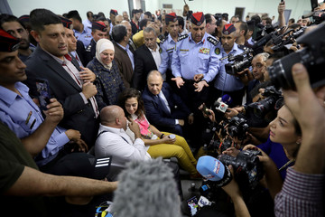 Jordanian citizen Hiba Labadi is surrounded by people and media members upon her release by Israel, at the King Hussein Bridge crossing near Amman