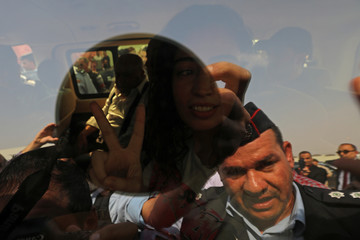 Jordanian citizen Hiba Labadi gestures from a vehicle upon her release by Israel, at the King Hussein Bridge crossing