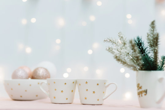Two cups for christmas cacao with marshmellous, golden stars, new year tree, scandinavian kitchen, festive background