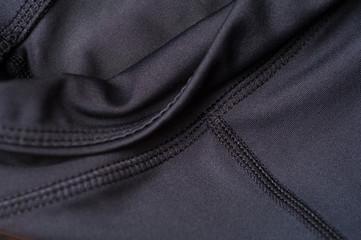 Close-up fragment of black nylon garment Fotomurales
