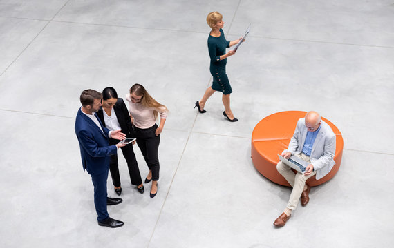 Diverse group of business people of all ages top view in modern interior