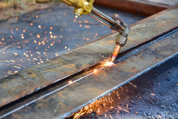 Worker cutting metal plate by Gas Cutting Torch in the workshop.