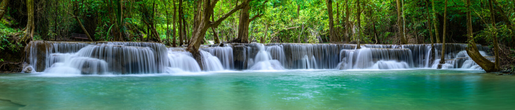 A beautiful waterfall deep in the tropical forest steep mountain adventure in the rainforest.
