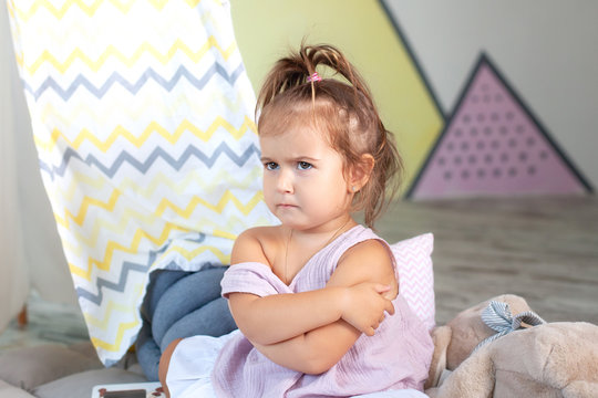 Wicked little girl. Concept sign and gesture, emotion. Upset little girl. concept of anger, disappointment and harm, copy space. lonely frightened little child, looking away,  feels abandoned offended