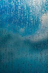 rain drops on window blue background