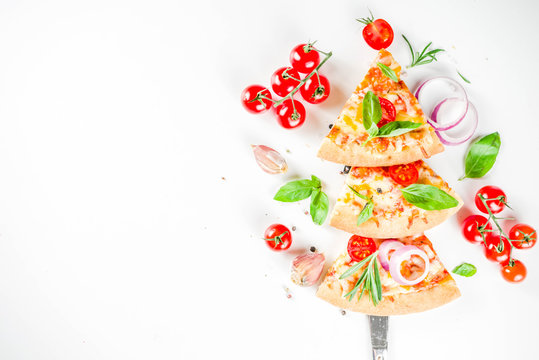 Pieces of cheese pizza Margarita, set like christmas tree. White stone background top view. Christmas and New year party food idea