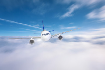 The plane flies low above the clouds.