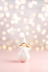 Close up of tiny pretty Angel dresses in white winter cloth