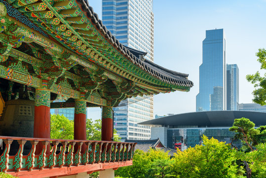 Traditional roof of Buddhist temple and scenic modern buildings