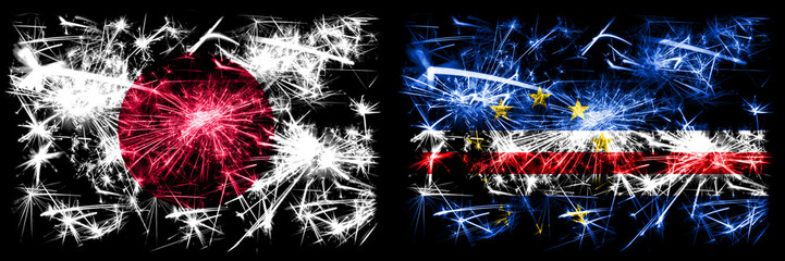 Japan, Japanese vs Cape Verde New Year celebration sparkling fireworks flags concept background. Combination of two abstract states flags Fototapete