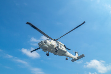 Poster Helicopter Military navy helicopter flying above the ocean.Copy space and background.