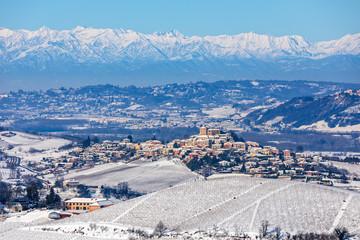 Small town on the hills coverd in snow in Northern Italy.