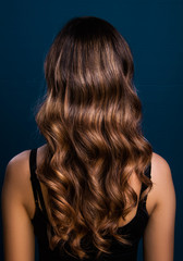 Balayage modern hair style long hair, model in studio, poster ready, isolated close up