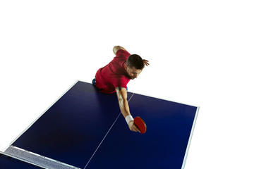 Wall Mural - Higher. Young man plays table tennis on white studio background. Model plays ping pong. Concept of leisure activity, sport, human emotions in gameplay, healthy lifestyle, motion, action, movement.