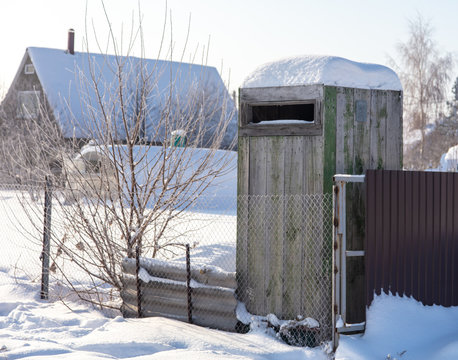 Wooden toilet in the snow