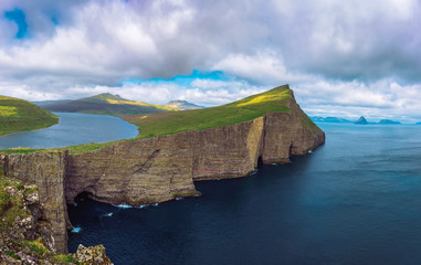 Wall Mural - Huge cliff and lake Sorvagsvatn on island of Vagar, Faroe Islands, Denmark.
