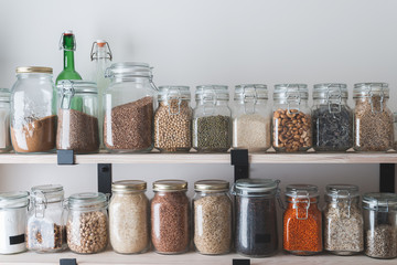 shelves with glass jars filled with groceries Wall mural