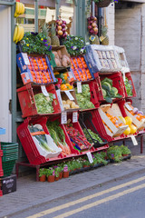 Traditional fresh fruit and vegetables pavement display outside green grocers shop in the UK