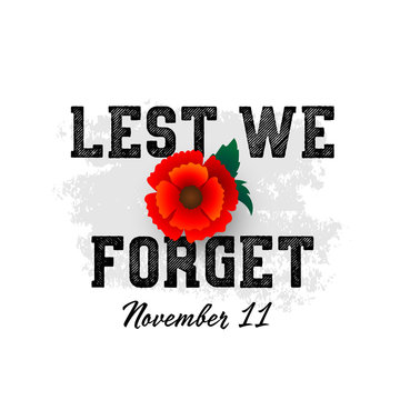 Remembrance Day November 11 typography with poppy flower - international symbol of peace, text is Lest we forget for Memorial Day Armistice Day anniversary celebration in British Commonwealth