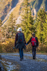 mother and son hiking in the mountains