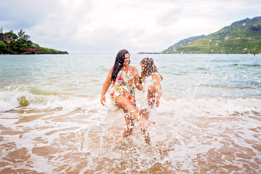 Mother and daughter playing in the Pacific Ocean