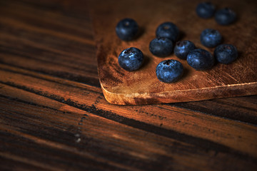 Closeup of fresh blueberries on rustic wooden table